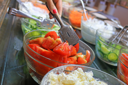 sorted: Sorted fresh salads displayed on a buffet in restaurant
