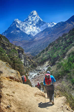 Goup of climbers in action, view on the Himalayas peak Ama Dablam, Nepal