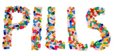 Pills letters made from pills and capsules on white table, medical treatment