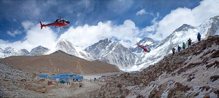Everest base camp Gorak Shep rescue helicopters in action Himalayas Nepal, small settlement that sits at its edge at 5,164 m elevation, near Mount Everest Imagens - 130966714