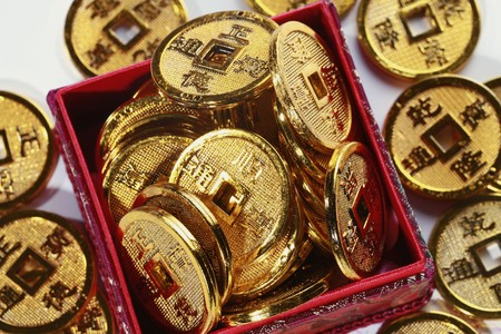 Red box overflowing with antique chinese coins Stock Photo - 4186965