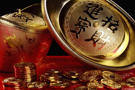 ingots: Golden ingots and antique chinese coins Stock Photo