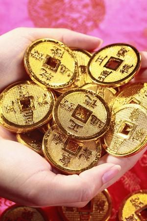 asian coins: Woman holding antique chinese coins