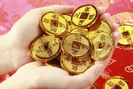 antique coins: Woman holding antique chinese coins