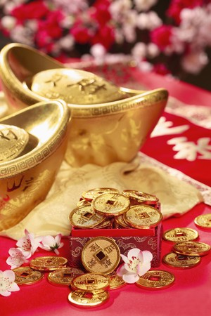 Gold ingots and antique chinese coins photo