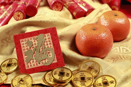 red packet: Red packet, antique chinese coins and mandarin oranges, firecrackers in the background