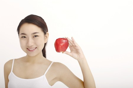Woman with a red apple Stock Photo - 4194549