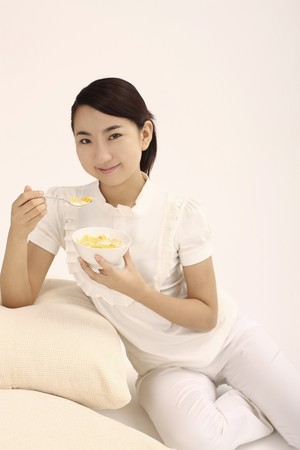 Woman enjoying her breakfast cereal photo