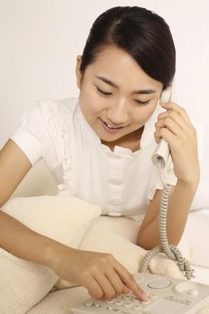 Woman making a phone call photo