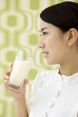 Woman with a glass of milk photo