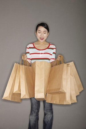 paperbags: Woman carrying paperbags