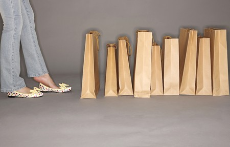 paperbags: Woman standing next to paperbags