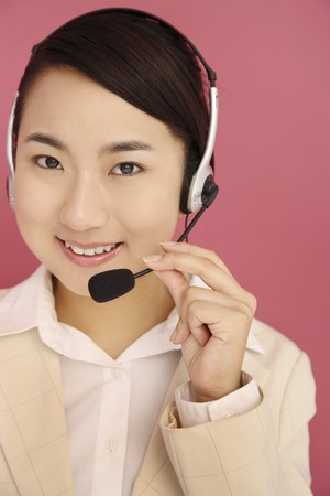Woman talking on the telephone headset photo
