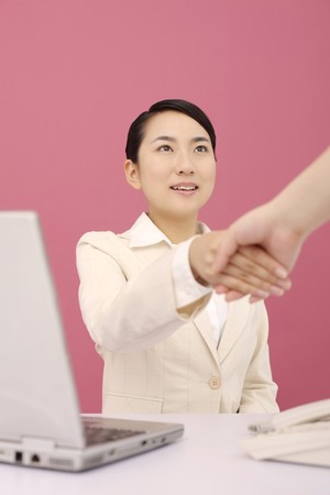Woman shaking hands Stock Photo - 4194427