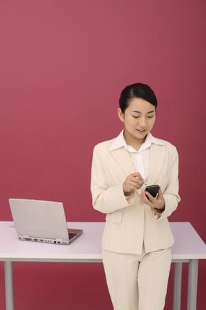 Woman using PDA phone Stock Photo - 4194310
