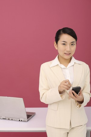 Woman using PDA phone photo