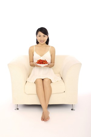 Woman holding a bowl of cherry tomatoes Stock Photo - 4194539