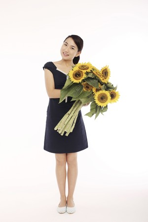 Woman posing with sunflowers photo