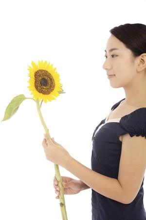 Woman looking at sunflower photo
