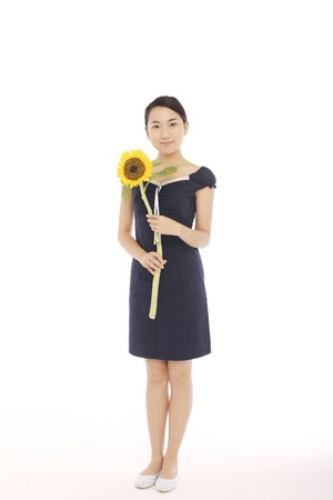 Woman posing with sunflower photo