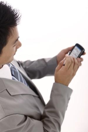 Businessman using PDA phone Stock Photo - 4194390