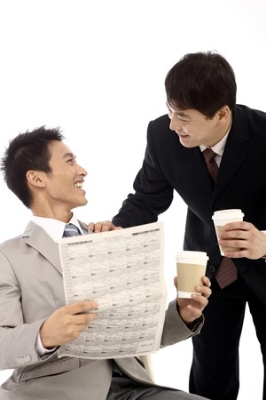 Businessmen chatting while drinking coffee photo