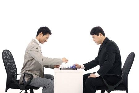 Businessmen playing chessgame