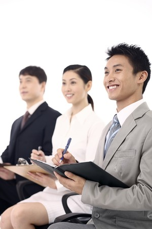Business people writing report
