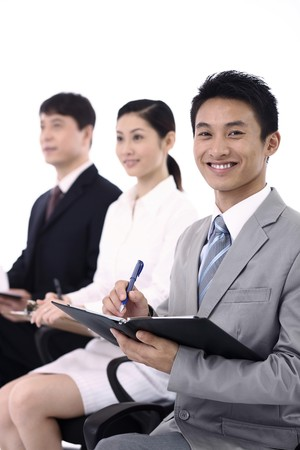 Business people writing report photo
