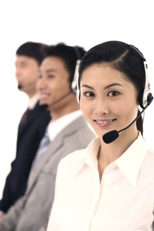 business attire: Business people with telephone headset