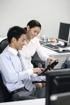 Businessman and businesswoman having discussion photo