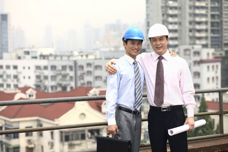Businessmen with safety helmets posing for the camera Stock Photo - 4194710