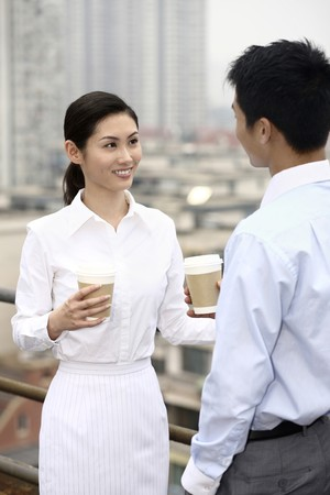 Business people drinking coffee while chatting photo