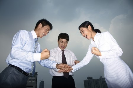 Business people stacking hands Stock Photo - 4194728