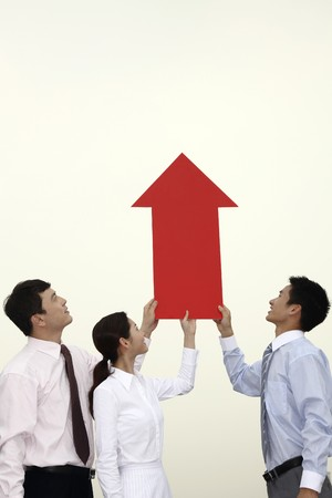 Business people holding an arrow showing up photo