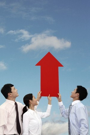 Business people holding an arrow showing up Stock Photo