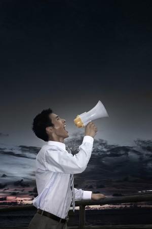 Businessman shouting through megaphone Stock Photo - 4194602