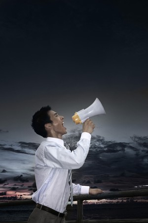 Businessman shouting through megaphone Stock Photo - 4194602