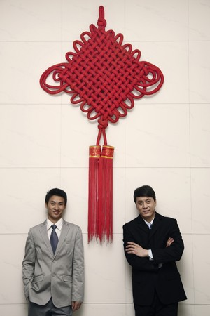 Businessmen posing under a giant Chinese New Year decoration Stock Photo - 4194655