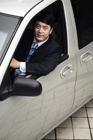Businessman smiling while sitting in the car