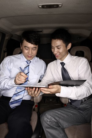Businessman signing contract in the car Stock Photo - 4194786