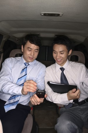 Businessmen discussing while traveling in the car Stock Photo - 4194792