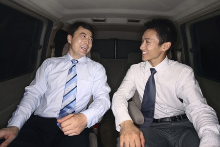 Businessmen chatting while traveling together in the car Stock Photo - 4194771