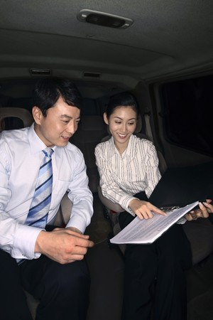 Businesswoman explaining the content of contract to businessman Stock Photo - 4194759