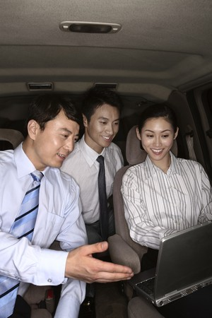 Business people having discussion in the car photo