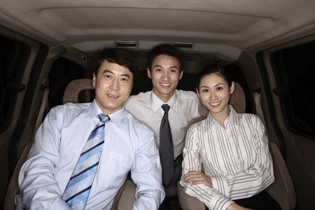 Business people smiling while sitting in the car Stock Photo - 4194784