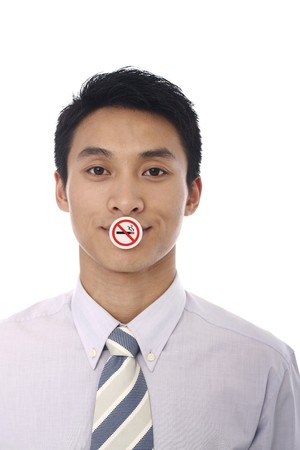 Businessman with a No Smoking sign covering his mouth photo
