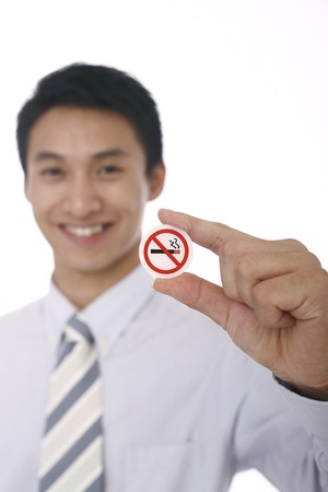 Businessman showing a No Smoking sign Stock Photo