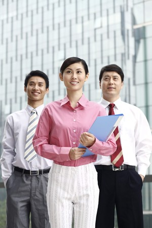 Business people standing in a group, smiling photo