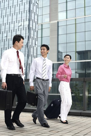 Business people chatting while walking photo
